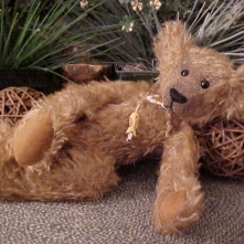 Fisher- Mohair Bear with Wobble Joints, Glass Eyes, and Carved Bone Fish Pendant