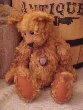 Roary- Cinnamon Curly Mohair Bear with Wobble Joints, Glass Eyes, Wearing a Rusty Jingle Bell.