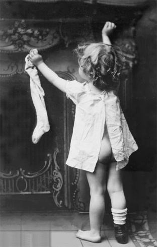 Little Girl with Bare Bottom Pinning Her Stocking