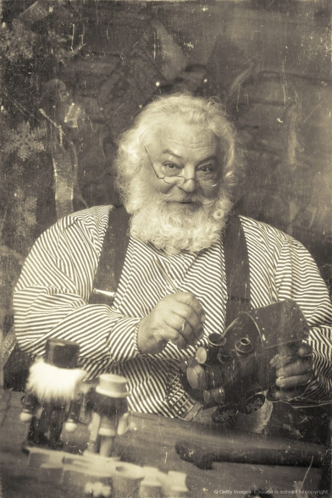 Vintage Santa Claus in his Workshop Making Toys